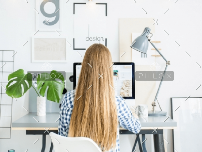 demo-attachment-928-happy-lady-sitting-in-office-coworking-while-P5AFND8