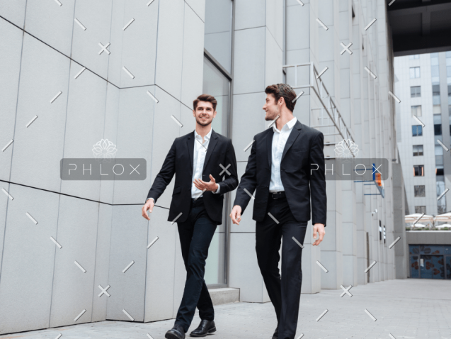 demo-attachment-922-two-businessmen-walking-and-talking-in-the-city-PMW8E26