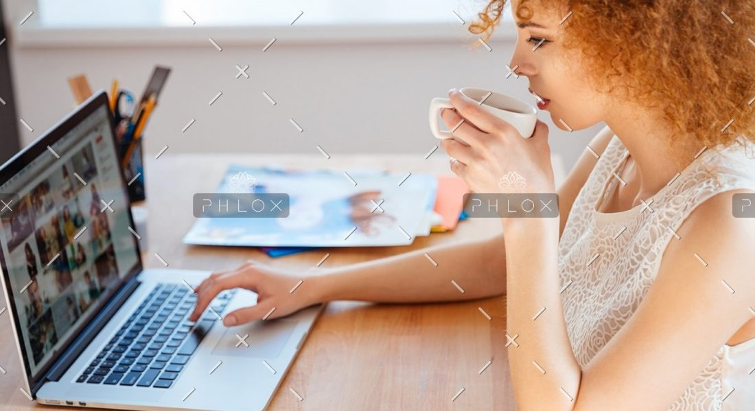 demo-attachment-218-woman-photographer-drinking-coffee-and-working-PJNBP6U@2x